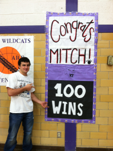 Mitchell Breuer with 100 Win Banner
